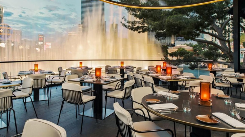 The outside patio at Spago overlooking the fountains and Las Vegas Strip.